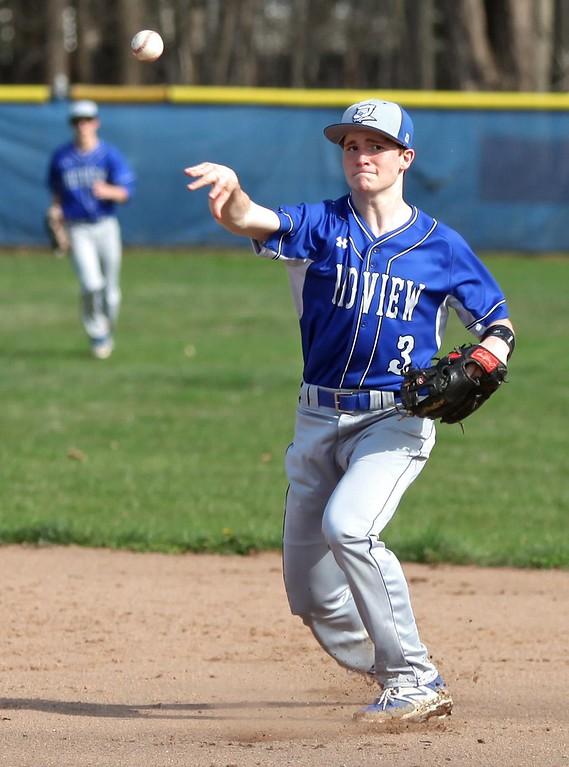 . Randy Meyers - The Morning Journal<br> Midview second baseman Cam Honis fields a ground ball and throws to first for the out against Olmsted Falls on April 10.
