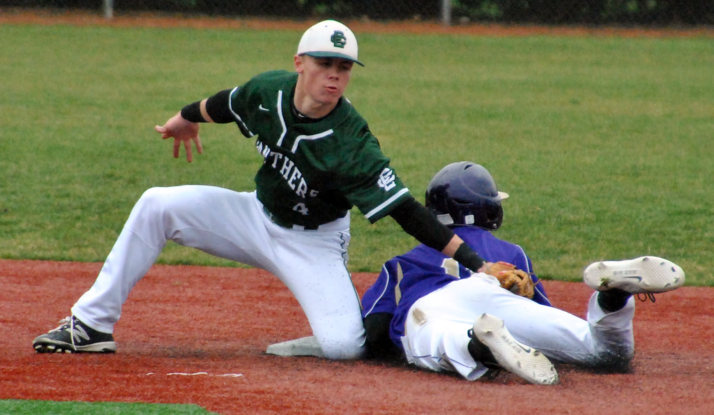 . Jon Behm - The Morning Journal<br> Elyria Catholic\'s Ryan Strittmather is late with the tag on Vermilion\'s Sterling Benko during the top of the second inning on March 28 at Oberlin College.