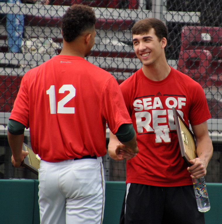 . Jon Behm - The Morning Journal<br> Elyria Catholic\'s Andrew Abrahamowicz, right, and Amherst\'s Xavier Moore shake hands after being named the 2017 Lorain County Mr. Baseball co-recipients.