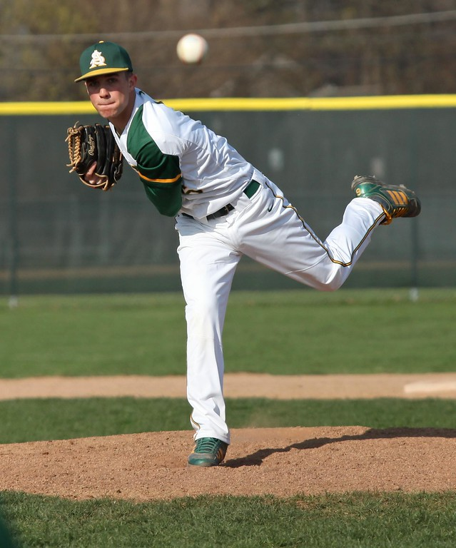 . Randy Meyers - The Morning Journal<br> Amherst pitcher Evan Shawver delivers a pitch against Avon on April 12.