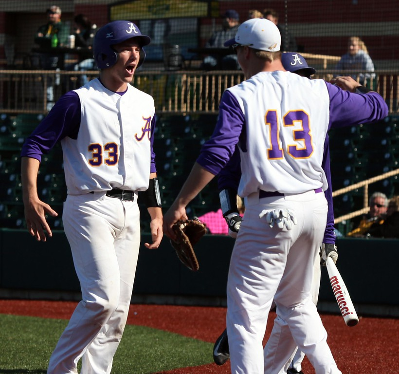 . Randy Meyers - The Morning Journal<br> Avon\'s Will Kocar is congratulated by teamate Logan Doenges after scoring against Amherst on May 3.