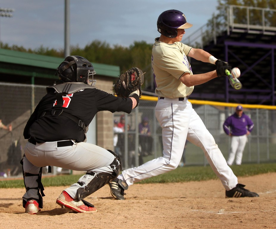 . Randy Meyers - The Morning Journal<br> Reese Miller of Vermilion connects with a pitch against Fostoria on May 10.
