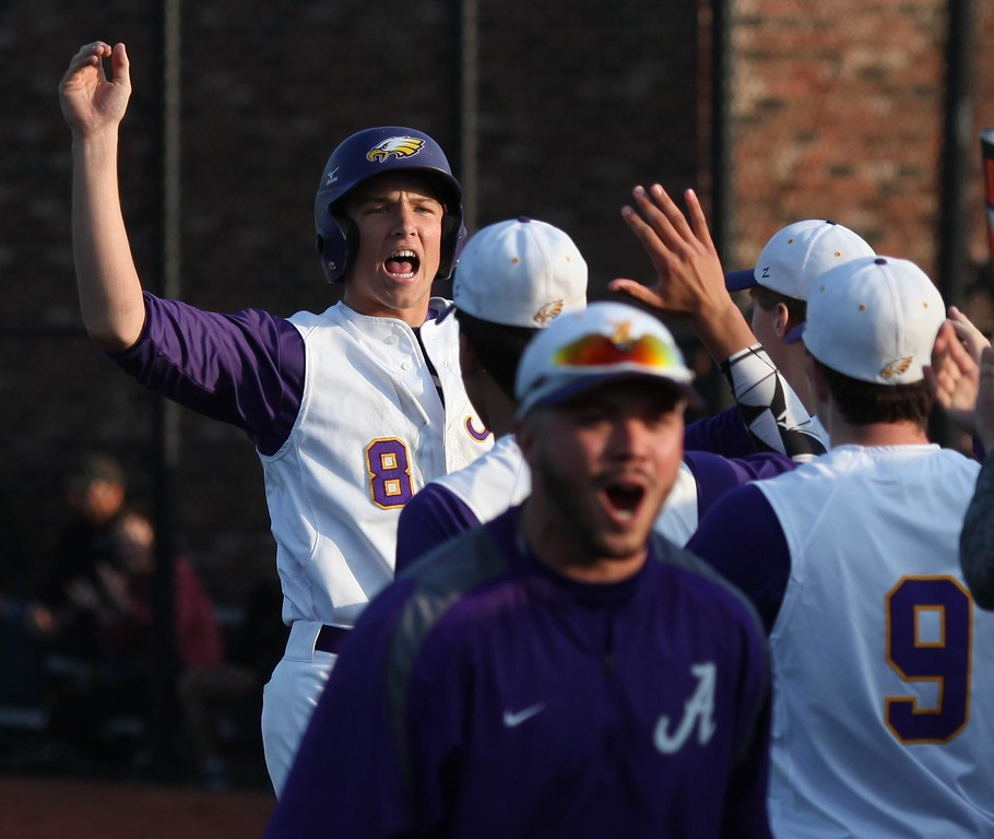 . Randy Meyers - The Morning Journal<br> Avon\'s Tommy Kocar scores against Medina during a late inning rally and the bench explodes with emotion on May 26.