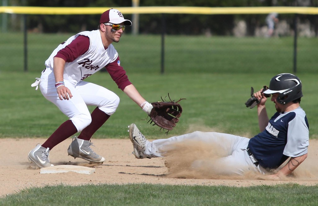 . Randy Meyers - The Morning Journal<br> Lorain\'s Raymond Rodriguez slides into second safely as Rocky River infielder Cam Blue waits on the throw on April 26.