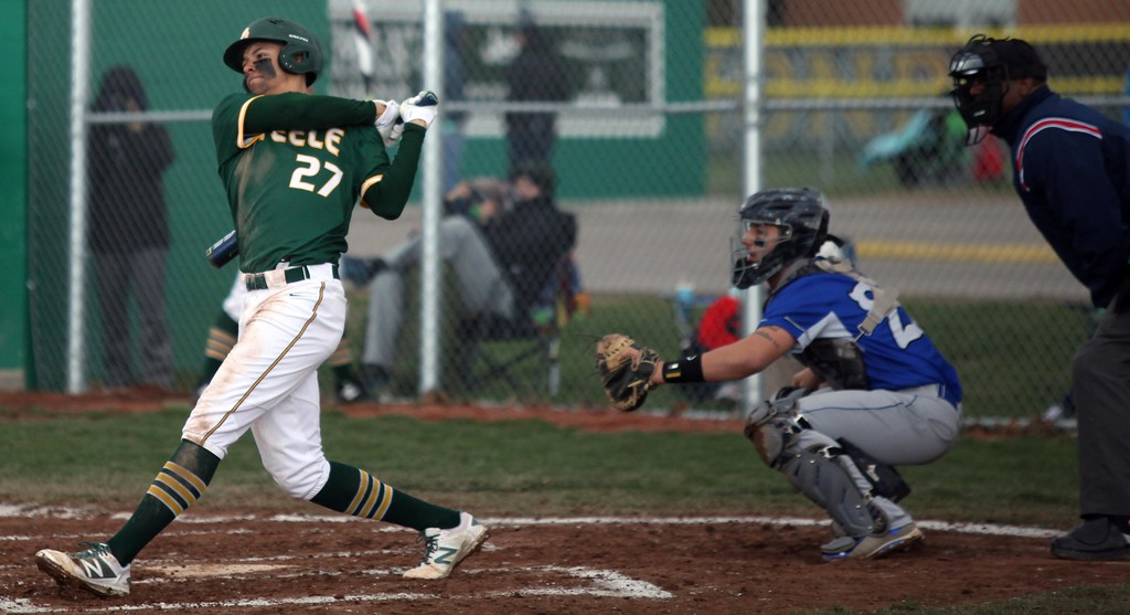 . Randy Meyers - The Morning Journal<br> Xavier Moore of Amherst lines a base hit against Midview on April 4. The Comets would won, 12-1.