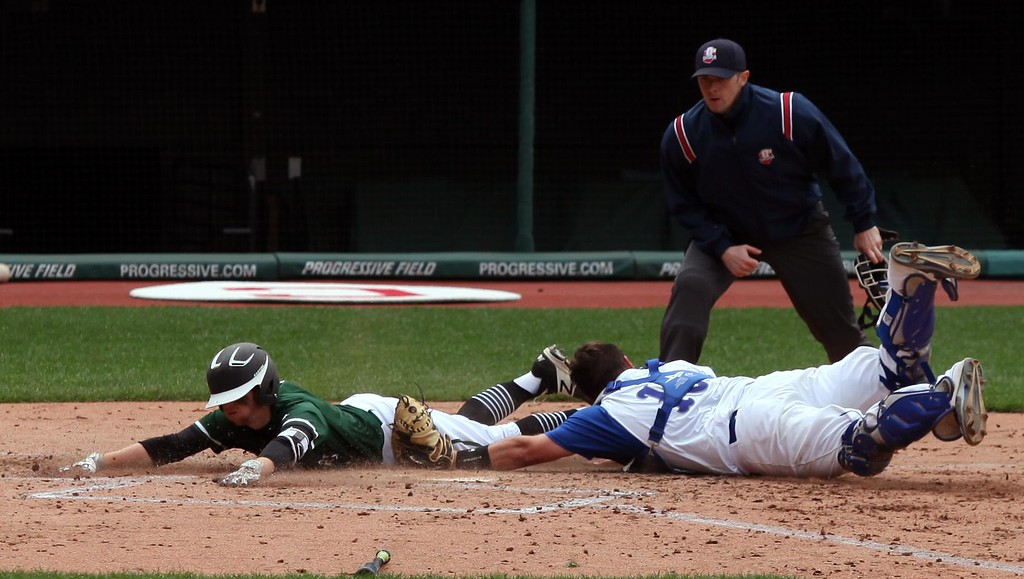 . Randy Meyers - The Morning Journal<br> Tony LoParo of Elyria Catholic slides into home safely to complete an inside the park home run against Hubbard during the Cleveland Indians Charities Hardball Classic at Progressive Field on April 21.
