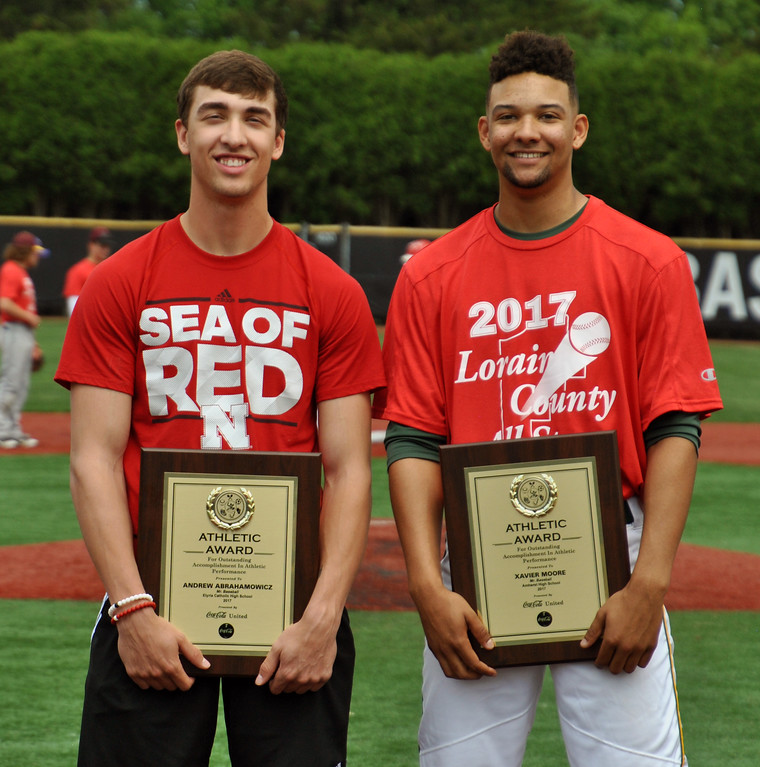 . Jon Behm - The Morning Journal<br> Elyria Catholic\'s Andrew Abrahamowicz, left, and Amherst\'s Xavier Moore pose after being named the 2017 Lorain County Mr. Baseball co-recipients.