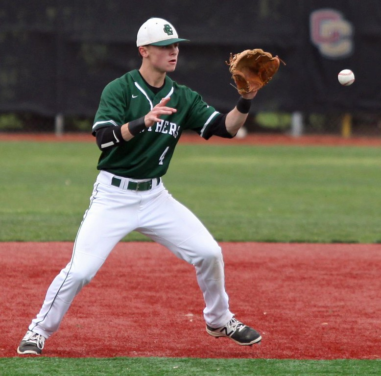 . Randy Meyers - The Morning Journal<br> Elyria Catholic second baseman Ryan Strittmather eyes a high grounder and makes the out at first against Bay on May 2.