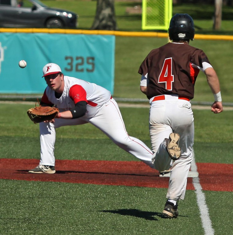. Randy Meyers - The Morning Journal<br> Firelands first baseman Calvin Stull eyes the throw and makes the out as Jonathon Neel of Buckeye runs down the line on May 15.