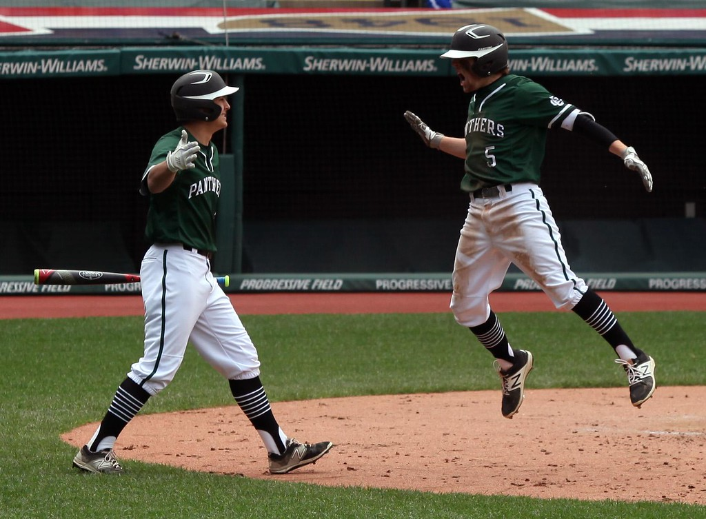 . Randy Meyers - The Morning Journal<br> Elyria Catholic\'s Tony LoParo, right, is congratulated by teammate Leighton Banjoff after an inside the park home run during the Cleveland Indians Charities Hardball Classic against Hubbard at Progressive Field on April 21.