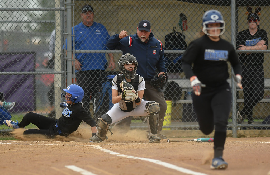. Eric Bonzar�The Morning Journal<br> Amherst catcher Lauren Kachure watches the Anthony Wayne runner after the force out at home, April 28, 2017.