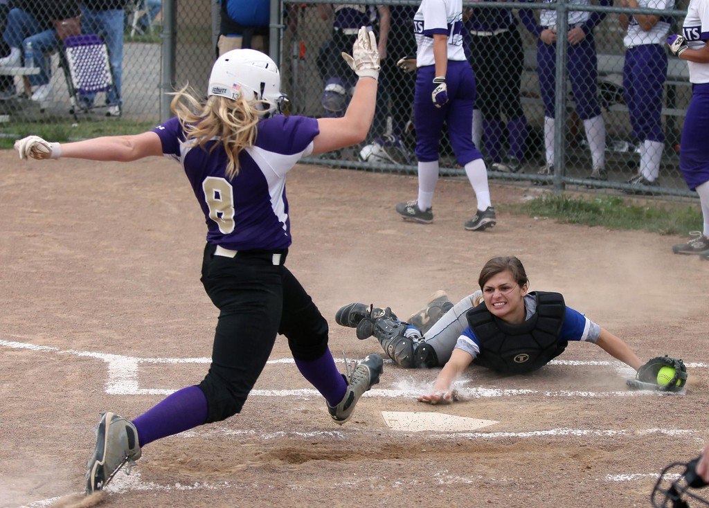 . Randy Meyers - The Morning Journal<br> Midview catcher Hannah Taulbee makes a diving stop but can\'t make the tag on Calli Brown of Vermilion at home plate during the Lorain County Senior All-Star Game on June 5.