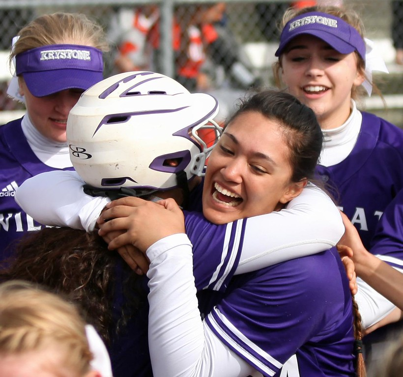 . Randy Meyers - The Morning Journal<br> Keystone\'s Madi Nunez is hugged by teammate Sammie Stefan after hitting a home run against Padua on May 11.