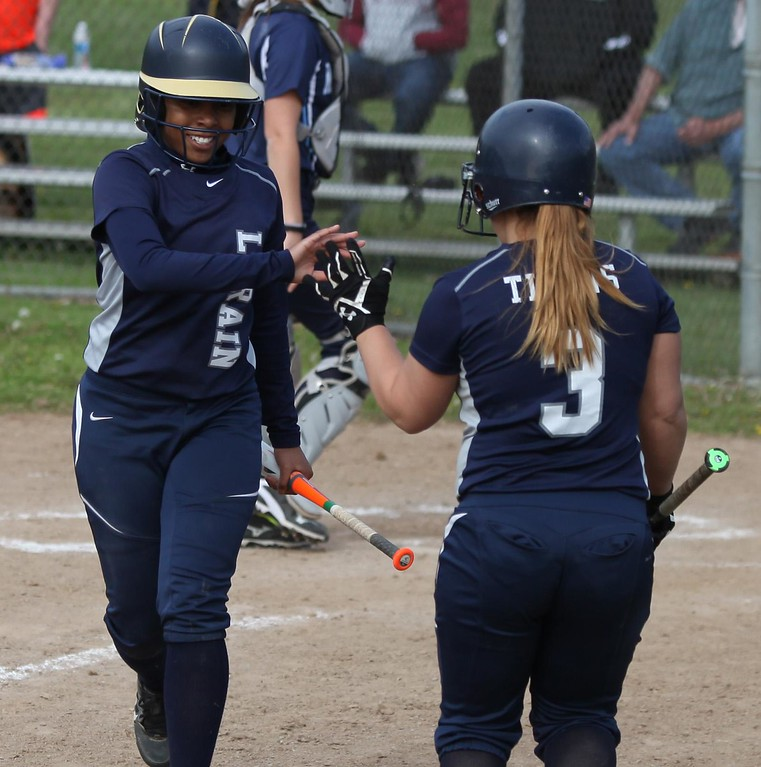 . Randy Meyers - The Morning Journal<br> Lorain\'s Talia Harris is congratulated by teammate Selena Shawver after scoring against Magnificat during a sectional semifinal on May 9.