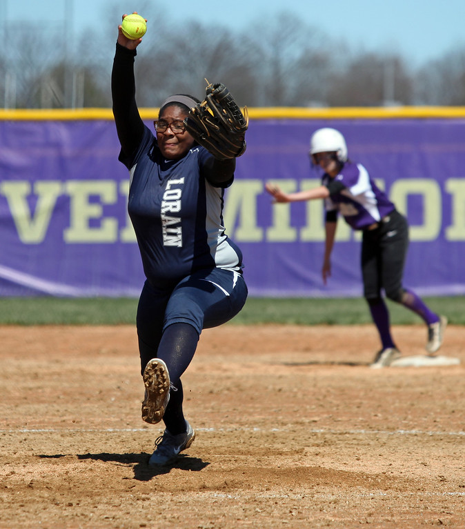 . Randy Meyers - The Morning Journal<br> Lorain\'s Alexis Moon delivers a pitch against Vermilion with a runner on base during the first game of a doubleheader on April 8.