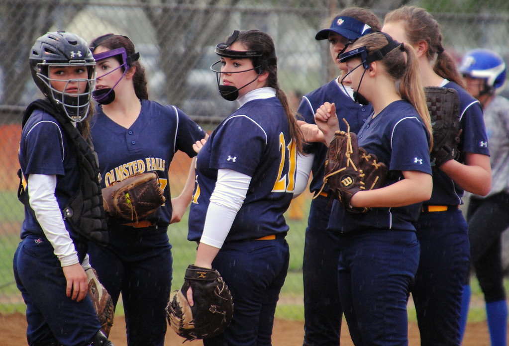 . Jon Behm - The Morning Journal<br> Olmsted Falls players look to the bench during the third inning against Brunswick on April 28 during the Prebis Memorial Invitational.