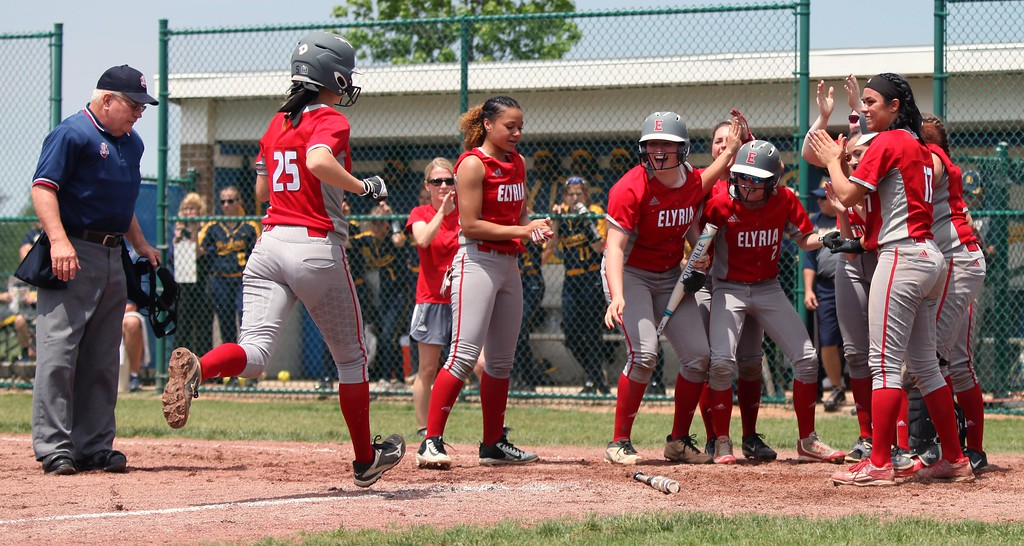 . Randy Meyers - The Morning Journal<br> Elyria\'s April Howser runs into a home plate celebration after she belted a sixth inning home run against Toledo Whitmer on May 27.