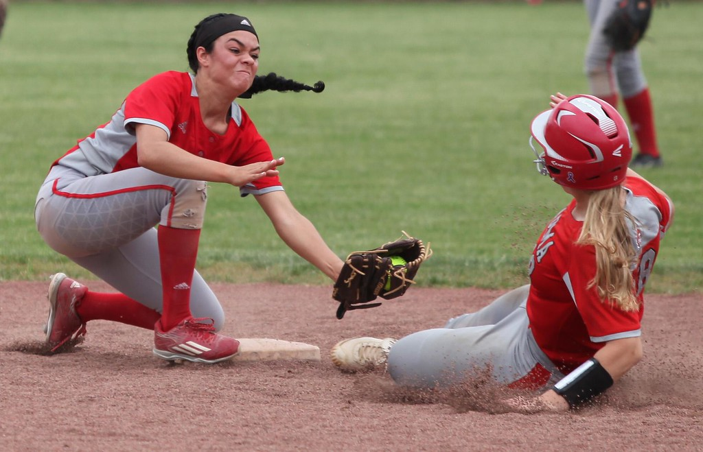 . Randy Meyers - The Morning Journal<br> Elyria infielder Dierra Hammons tags Andrea Scali of Parma at second base on May 24.