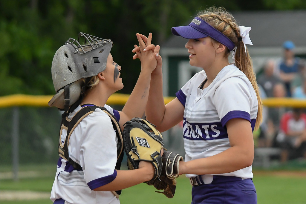 . Eric Bonzar�The Morning Journal<br> The Keystone Wildcats pitcher Sydney Campbell celebrates with catcher Autumn Acord in the pitcher\'s circle, May 27, 2017.