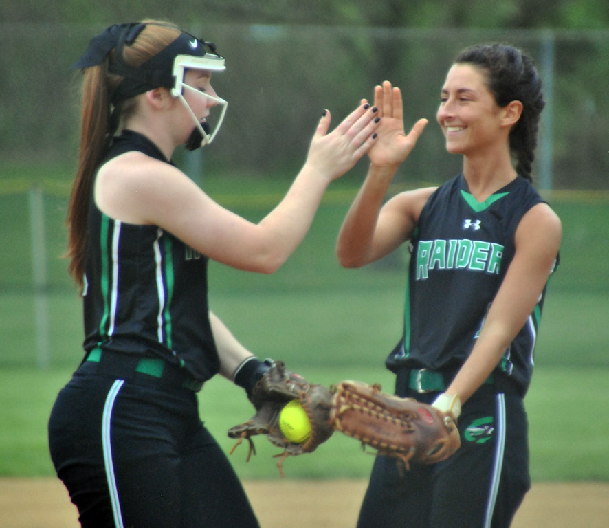 . Jon Behm - The Morning Journal<br> Columbia\'s Allison Bouscher, left, is congratulated by teammate Audrey Chonko after a strikeout during the top of the first inning against Nordonia on April 28 at Wellington Community Park.