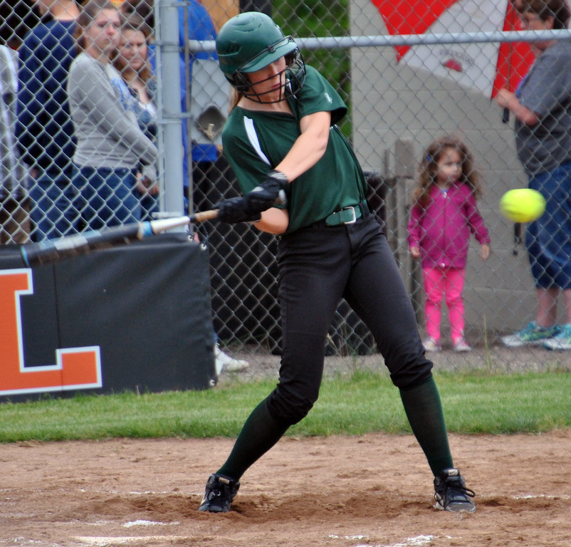 . Jon Behm - The Morning Journal<br> Elyria Catholic junior Maddy Knoth takes a swing during the bottom of the second inning against Massillon Tuslaw in a Division III Massillon Region semifinal on May 24.