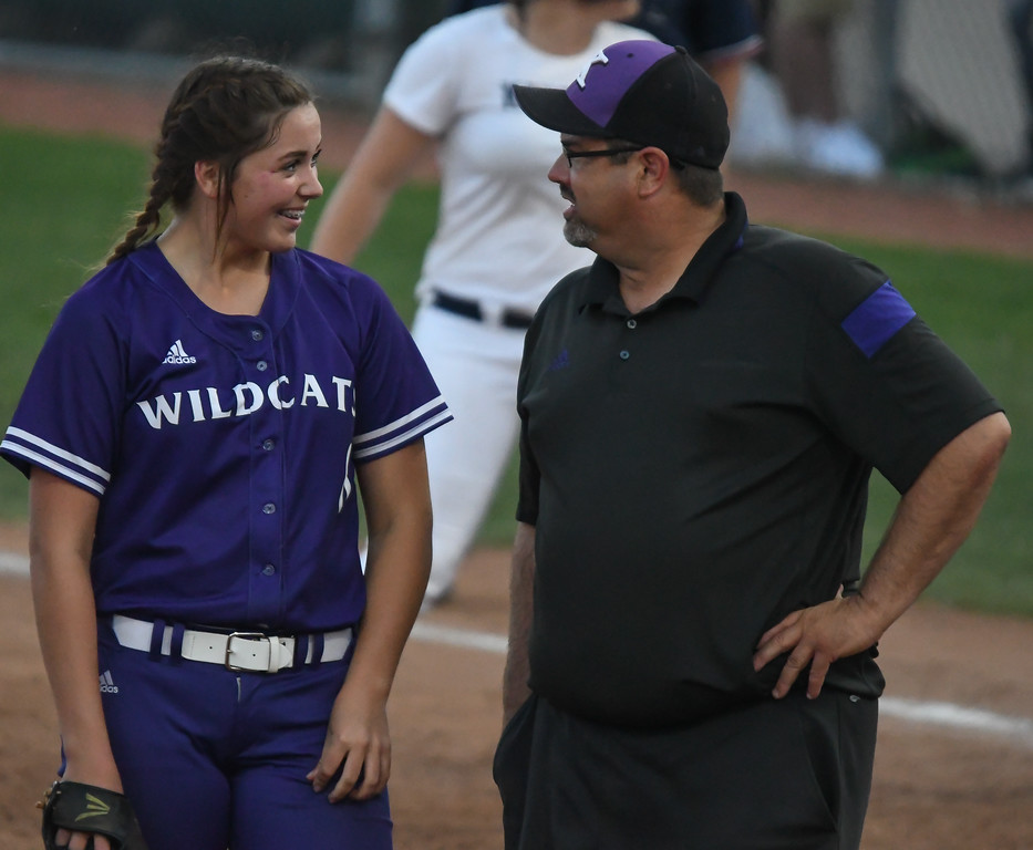. Eric Bonzar�The Morning Journal<br> Keystone \'s Lauren Shaw and coach Jim Piazza share a moment in the circle in the top of the fifth inning. Shaw pitched five innings, giving up seven hits and five runs, in the Wildcats\' D-II state semifinal loss against the Akron Hoban Knights, June 2, 2017.
