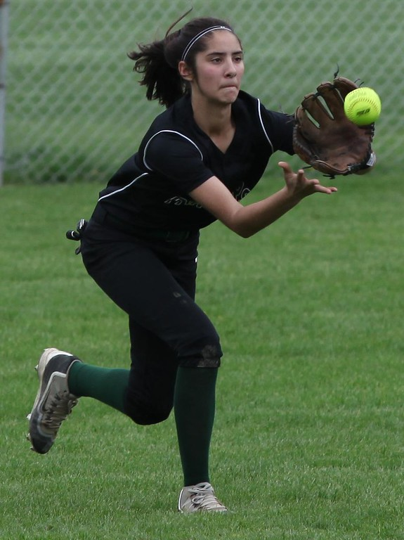 . Randy Meyers - The Morning Journal<br> Elyria Catholic center fielder Stephanie Griffin catches a line drive for the out against Rocky River on April 20.