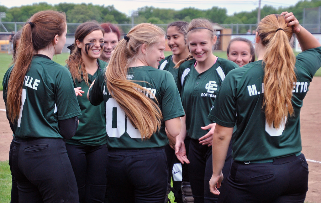 . Jon Behm - The Morning Journal<br> Elyria Catholic players talk after player announcements prior to their Division III Massillon Region semifinal against Massillon Tuslaw on May 24.