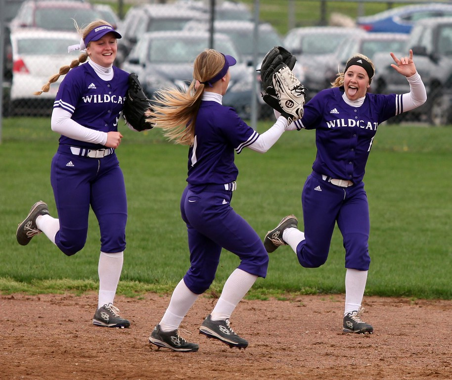 . Randy Meyers - The Morning Journal<br> Keystone right fielder Marlie McNulty, right, celebrates with her teammates after making a great over the shoulder catch for and out on April 22.
