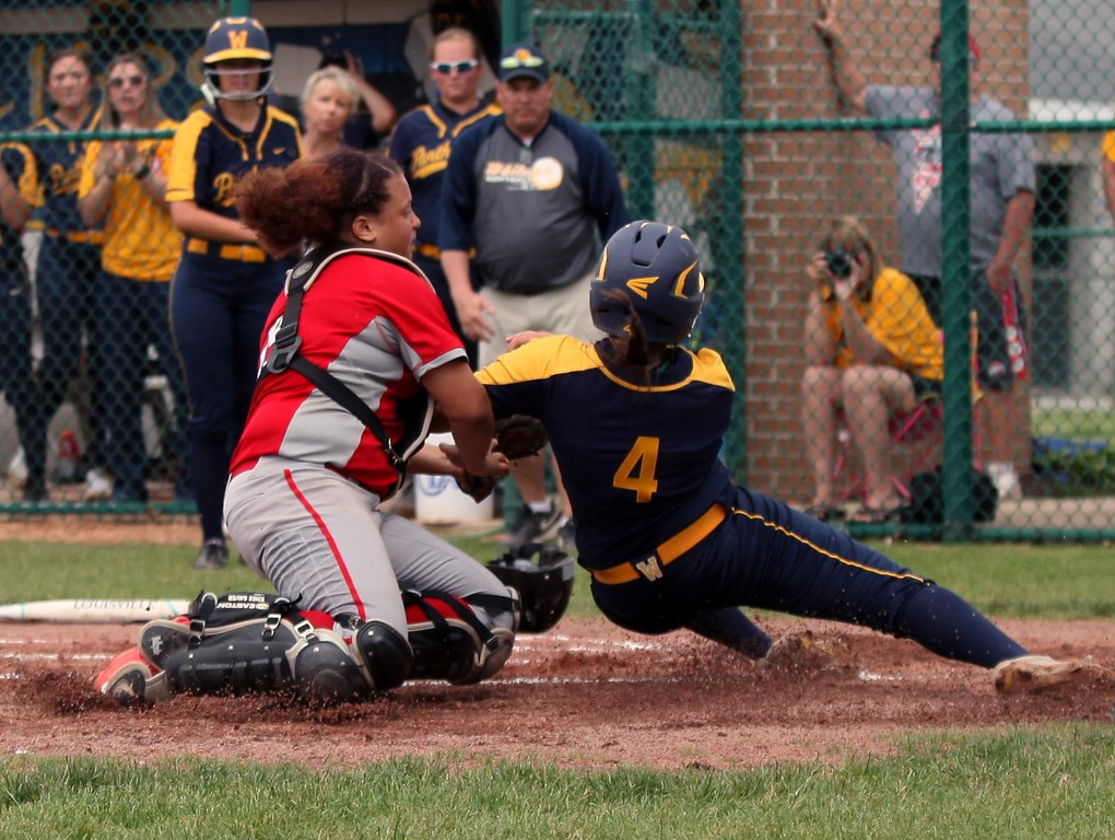 . Randy Meyers - The Morning Journal<br> Elyria catcher Maycee Godbolt tags out Kaylee Keesee of Toledo Whitmer at home plate on May 27.