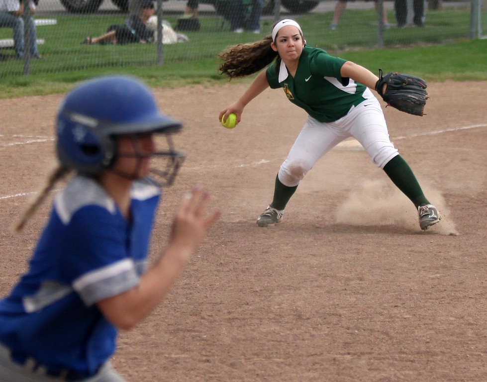 . Randy Meyers - The Morning Journal<br> Amherst third baseman Adrianna Marcano fields a ground ball and throws out the Midview runner on April 19.