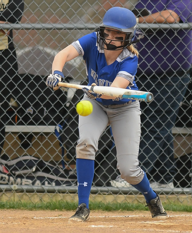. Eric Bonzar�The Morning Journal<br> Midview\'s Sara Liszeski attempts to lay down a bunt against Perrysburg, April 28, 2017.