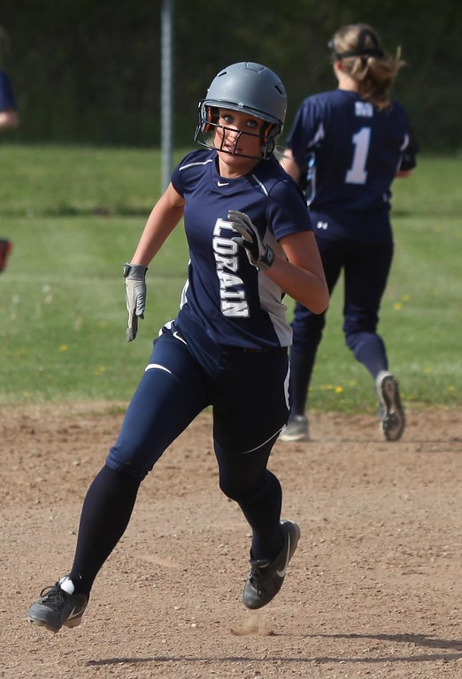 . Randy Meyers - The Morning Journal<br> Lorain\'s Raegan Osko rounds second base and heads for third against Magnificat on May 9.