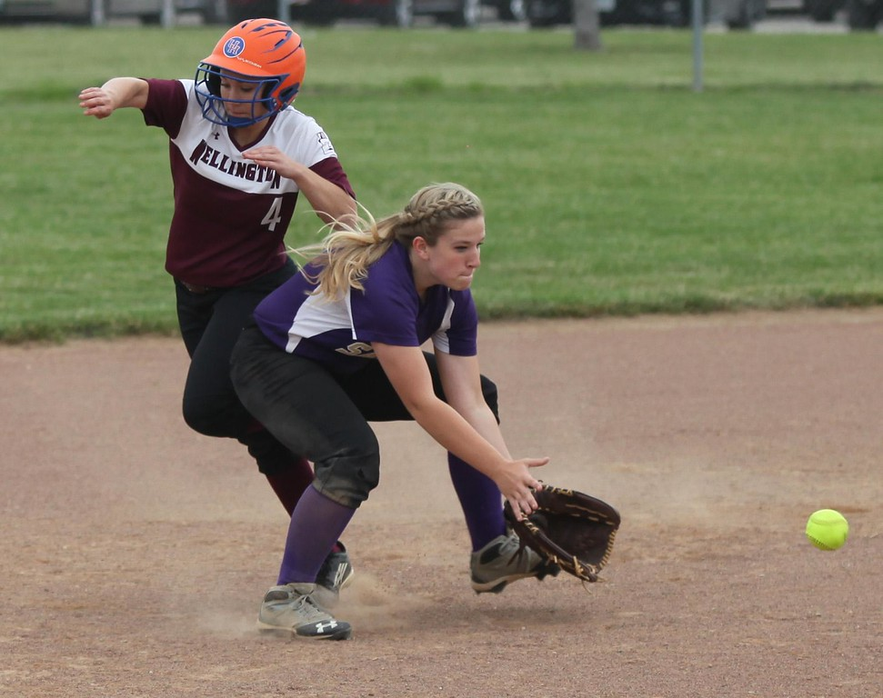. Randy Meyers - The Morning Journal<br> Vermilion\'s Calli Brown fields a ground ball in front of Wellington\'s Krista Denney as she heads to third during the Lorain County Senior All-Star Game game on June 5.