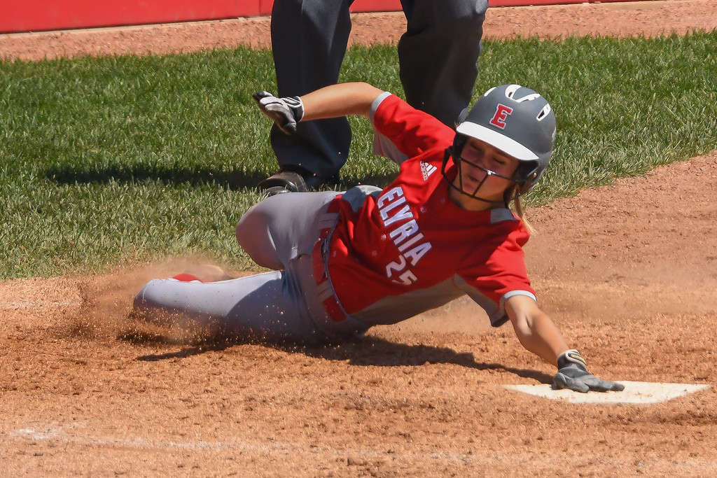 . Eric Bonzar�The Morning Journal<br> Elyria\'s April Howser scores the tying run in the bottom of the seventh inning against Lebanon on June 3.