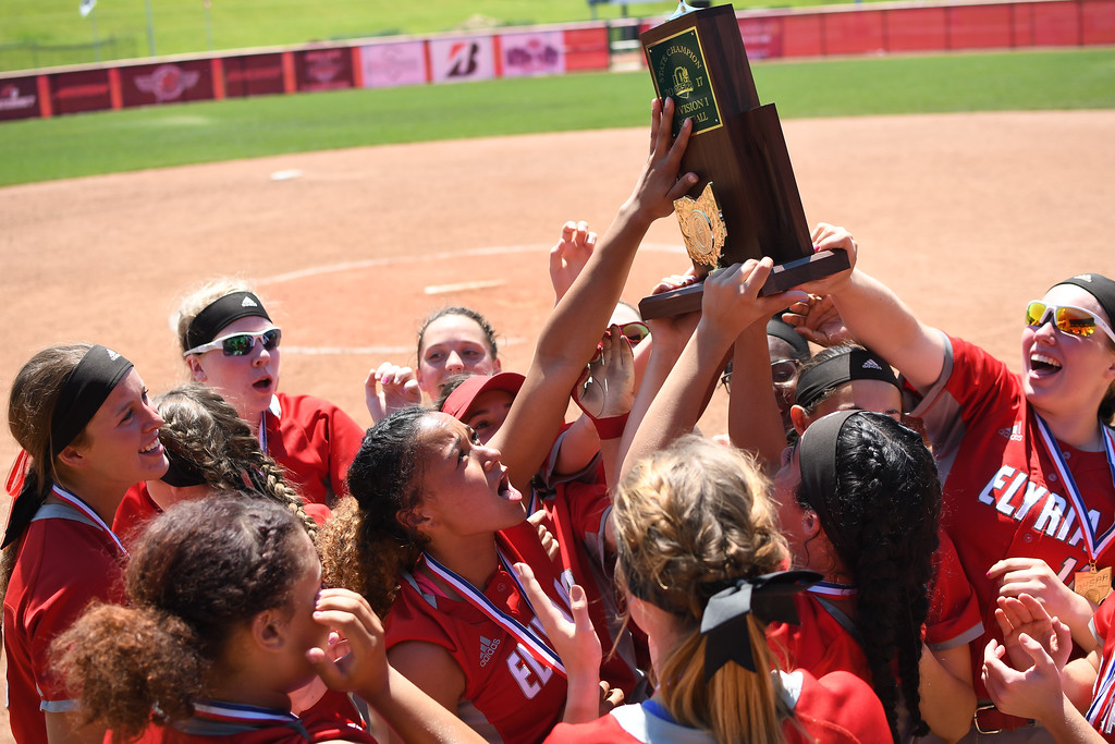 . Eric Bonzar�The Morning Journal<br> The Elyria Pioneers raise the team\'s D-I state championship trophy after defeating the Lebanon Warriors, 4-3, June 3, 2017.