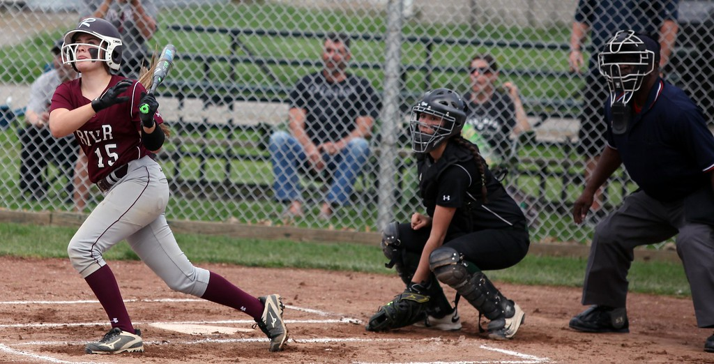 . Randy Meyers - The Morning Journal<br> Marissa Smiley of Rocky River hits the ball to left field against Elyria Catholic on April 20.