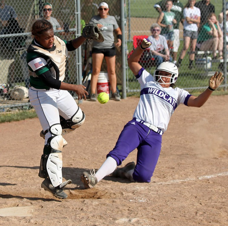 . Randy Meyers - The Morning Journal<br> Holy Name catcher Annessa Whitlow can\'t control the ball at home plate as Keystone\'s Sammie Stefan slides in safely on May 18.