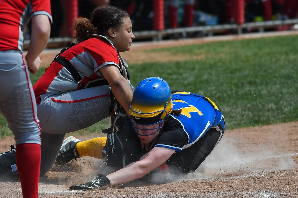 . Eric Bonzar�The Morning Journal<br> Elyria freshman catcher Maycee Godbolt tags Gahanna Lincoln\'s Kristen Zink out at home plate in the top of the seventh inning on June 1.