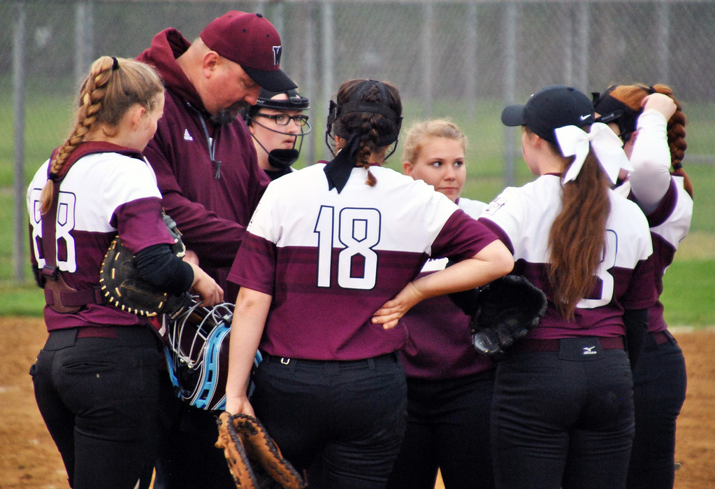 . Jon Behm - The Morning Journal<br> Wellington\'s infield takes a moment to discuss strategy during the top of the second inning against Girard on April 28 at Wellington Community Park.