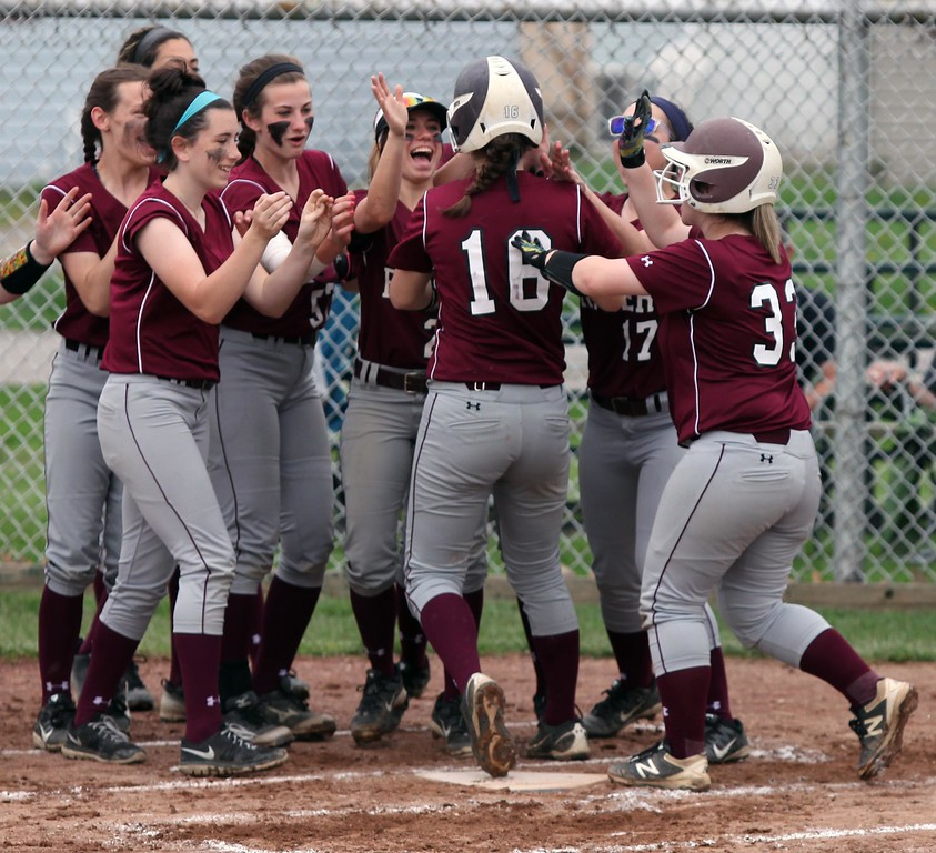 . Randy Meyers - The Morning Journal<br> Rocky River\'s Maureen Cain is congratulated by her teammates after hitting a home run against Elyria Catholic on April 20.