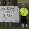 Jen Forbus - The Morning Journal<br /> Future Wildcats gather early to line up for the parade with their signs.