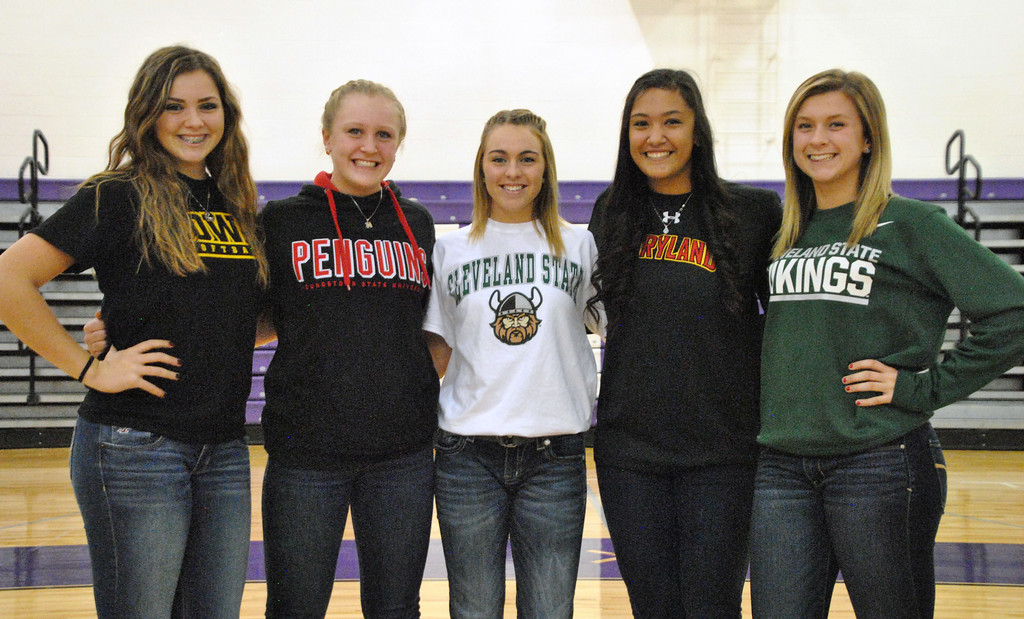 . Jon Behm - The Morning Journal<br> Keystone softball players, from left to right, Lauren Shaw, McKenah Peters, Paige Hartley, Sammie Stefan and Madi Cendrosky signed their letters of intent to play Division I athletics on Nov. 10.