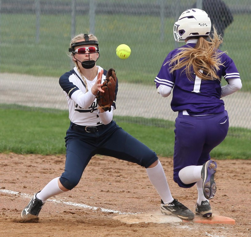 . Randy Meyers - The Morning Journal<br> Marlie McNulty of Keystone beats the throw to first as Zoe Lehtonen covers for Pittsford Sutherland on April 22.