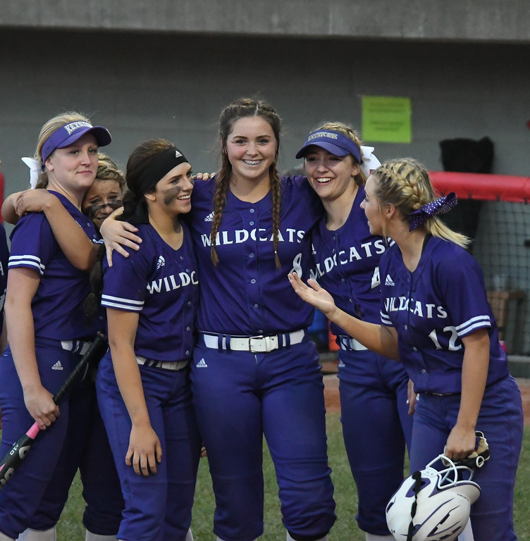 . Eric Bonzar�The Morning Journal<br> Keystone \'s Lauren Shaw, middle, and her fellow teammates are all smiles after dropping the D-II state semifinal game against the Akron Hoban Knights, June 2, 2017.