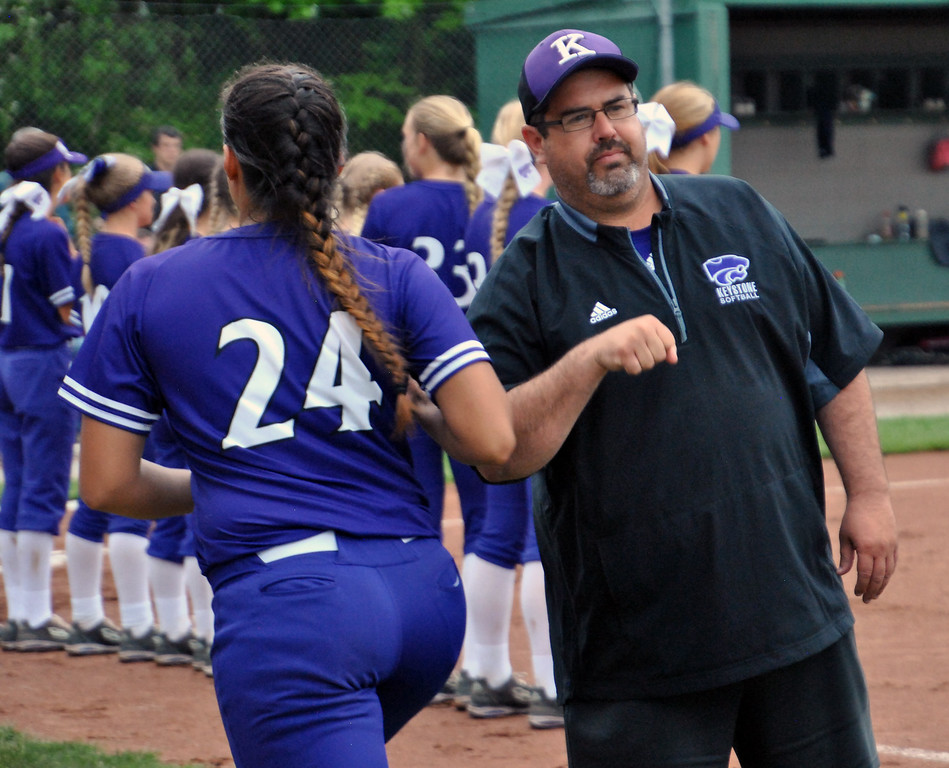 . Jon Behm - The Morning Journal<br> Keystone coach Jim Piazza bumps arms with Keystone senior Sammie Stefan prior to their Division II Tiffin Region semifinal game against Napoleon on May 25.