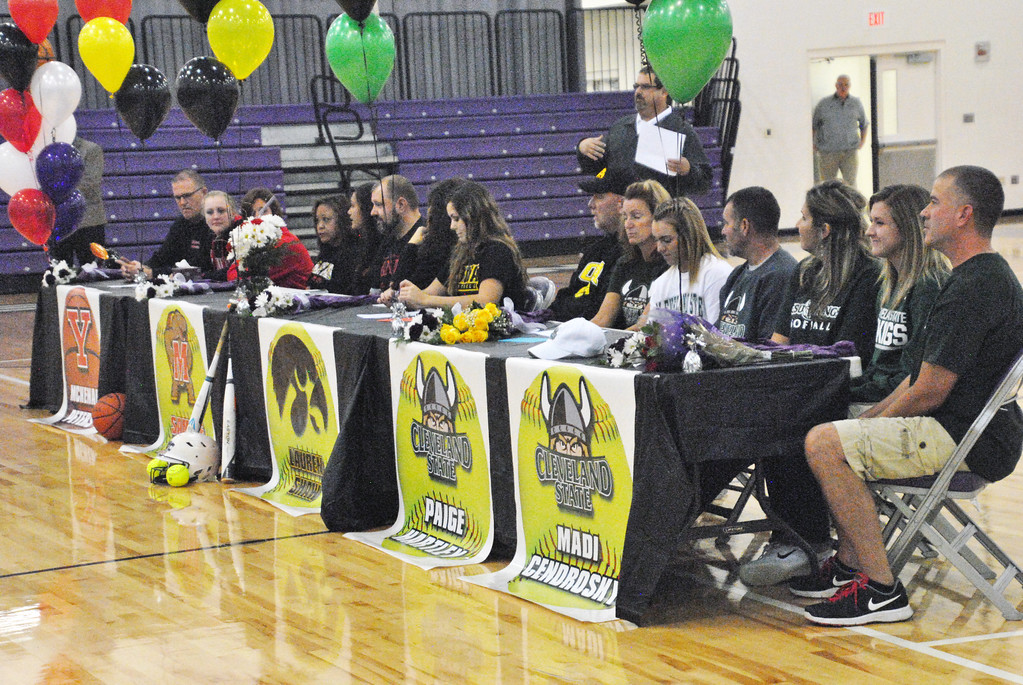 . Jon Behm - The Morning Journal<br> McKenah Peters, Sammie Stefan, Lauren Shaw, Paige Hartley, and Madi Cendrosky, along with their families and friends, listen as Keystone coach Jim Piazza talks before signing their letters of intent to play Division I athletics on Nov. 10.