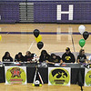 Jon Behm - The Morning Journal<br> Keystone softball players, from left to right, McKenah Peters, Sammie Stefan, Lauren Shaw, Paige Hartley, and Madi Cendrosky sign their letters of intent to play Division I athletics as their families and frends watch on Nov. 10.