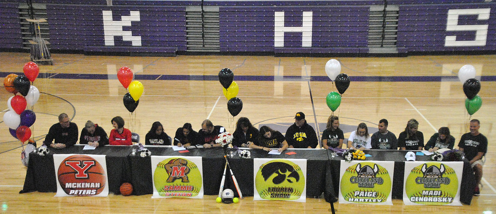 . Jon Behm - The Morning Journal<br> Keystone softball players, from left to right, McKenah Peters, Sammie Stefan, Lauren Shaw, Paige Hartley, and Madi Cendrosky sign their letters of intent to play Division I athletics as their families and frends watch on Nov. 10.