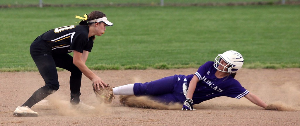 . Randy Meyers - The Morning Journal<br> Keystone\'s Marlie McNulty slides into second base before the tag by Kim Borck of Perry on April 28.